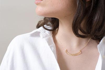 woman wearing handmade necklace