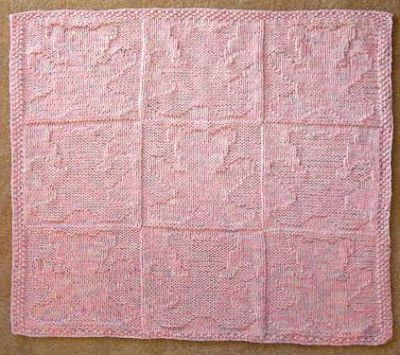 Pink blanket with teddy bear pattern