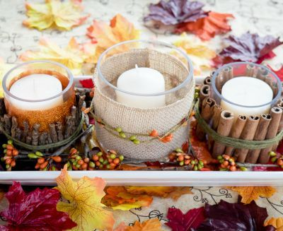 Candles decorated with fall accessories
