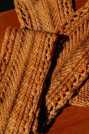 Golden scarf with latched stitching