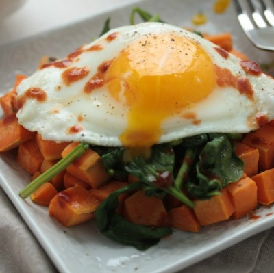 Over-easy egg on top of sweet potato hash
