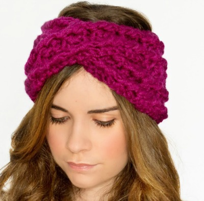 Magenta headband that cris-crosses in the front