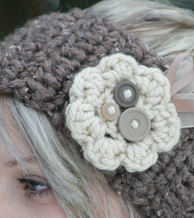 Crochet headband with decorative flower