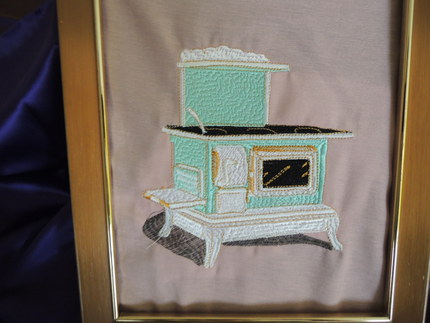 framed embroidered art, antique stove