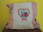 throw pillow/cushion with heart and flowers