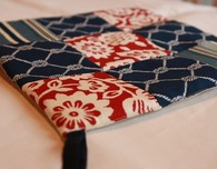 Quilted pot holders and matching kitchen towels
