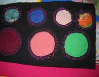 Wagon Wheel Cover Using Reverse Applique Circles