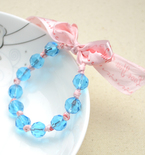 A Bracelet with Ribbon and Beads