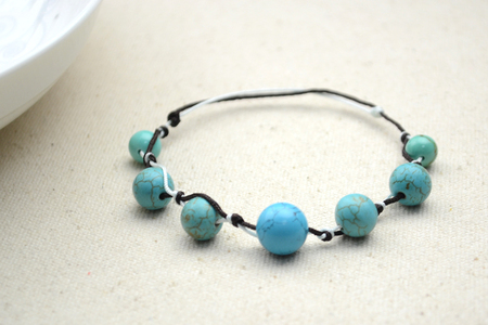 A Knotted Bracelet with Beads