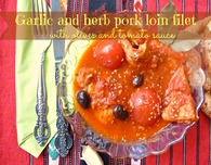 Garlic and herb pork loin with olives and tomato sauce