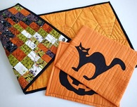 Scrappy reversible Halloween table mats