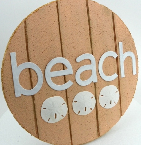 Carved foam beach sign