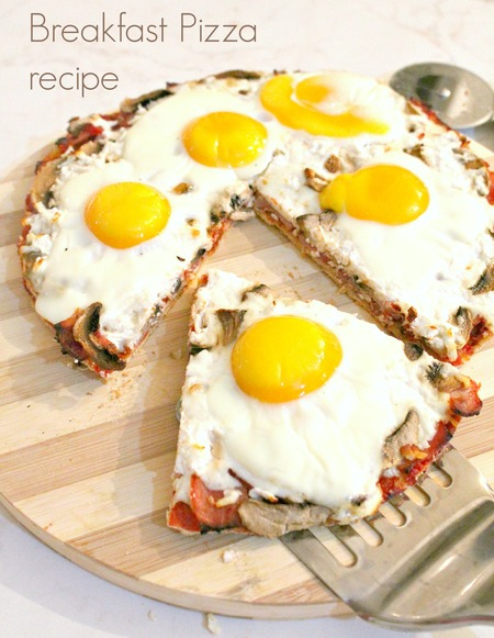 Breakfast pizza with eggs, ham and mozzarella