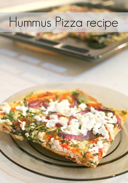 Hummus pizza with feta cheese, cumin and arugula