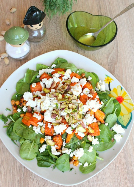 Baby spinach salad with roasted carrots, feta and pistachios