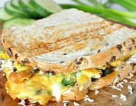 Omelette sandwich with sun dried tomatoes, 3 cheeses & green onions