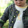 small child wearing knit sweater