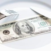 fork-and-knife-on-money