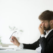 Upset business owner recovering from a rejected loan application/