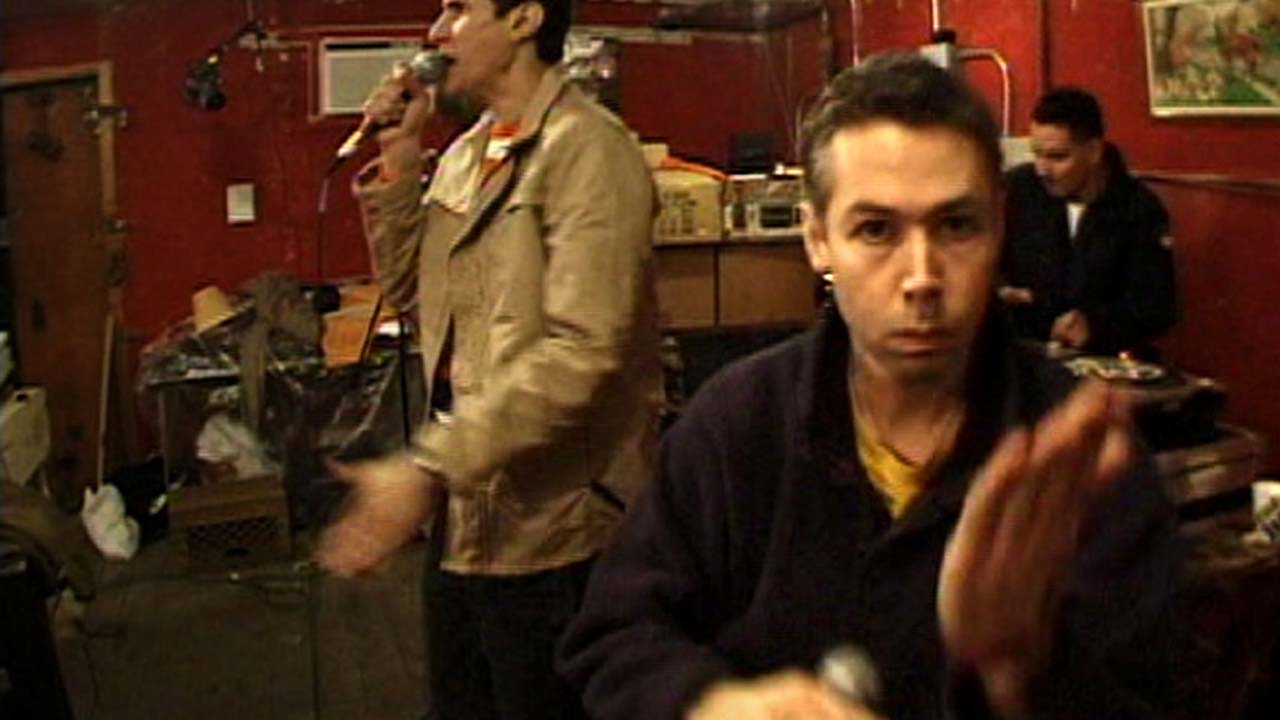 "Adam Yauch Performing ""Three MCs and One DJ"""