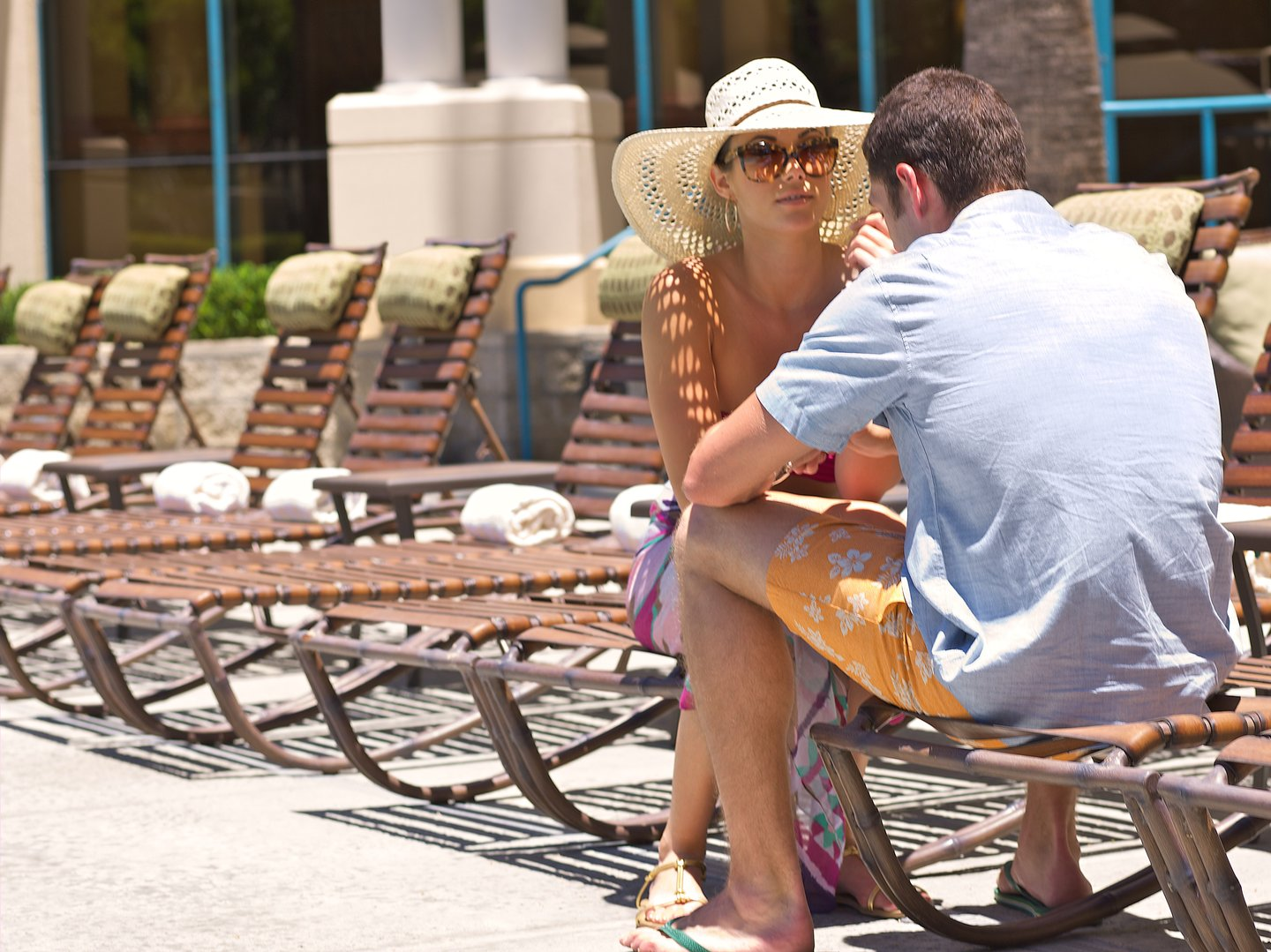 Couple sitting by the pool at Costa Mesa Marriott