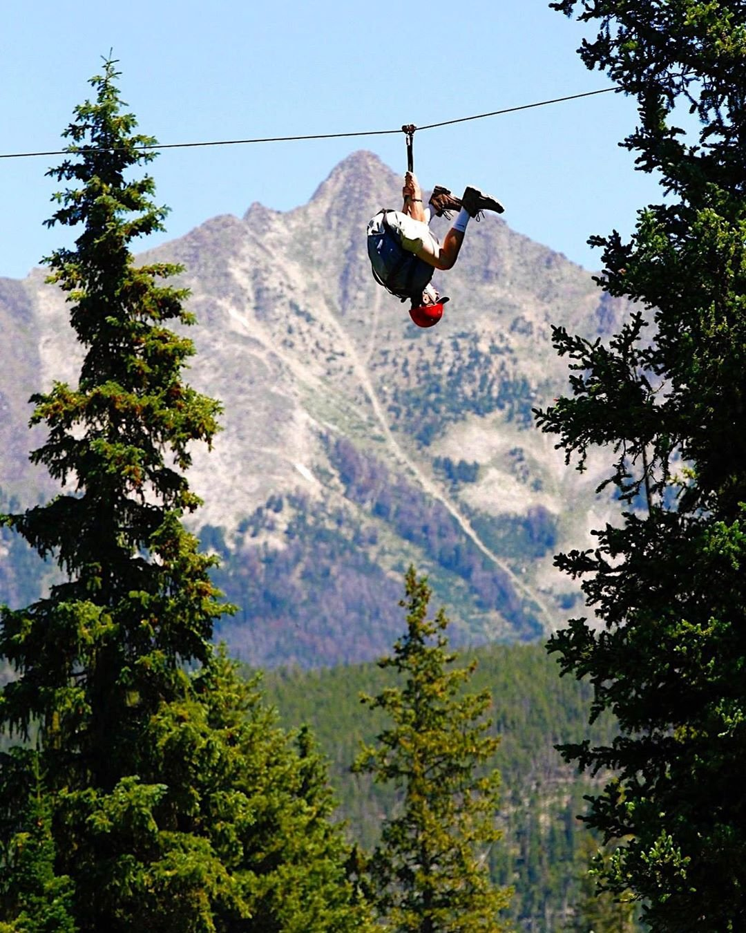 Photo by user whyitsmesky, caption reads Spider-Man tryouts  #bigskymontana #tbt #zipline #bigskyresort #nature #outdoors