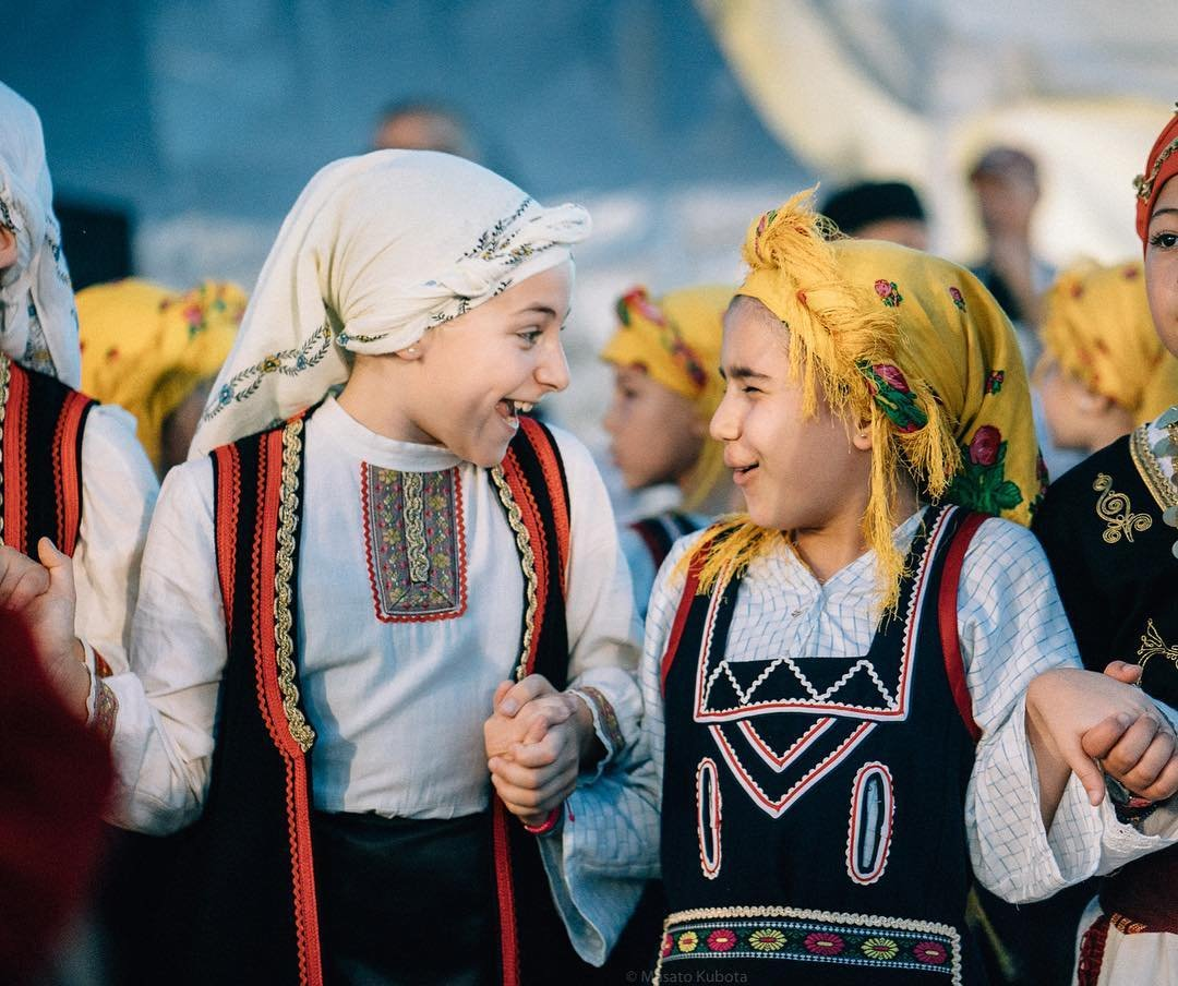 Photo by user kubm_az, caption reads Greek tradition goes strong generation to generation. Greek Festival is a popular and my favorite event in October, showcasing the culturally diverse community we live in. #greek #greekfestival #phoenix #arizona #greekdance #greekdancing #batis85 #a7rii #autumnfestivities #autumnfestival #giggles #holdinghands #traditionalmusic #traditionaldance