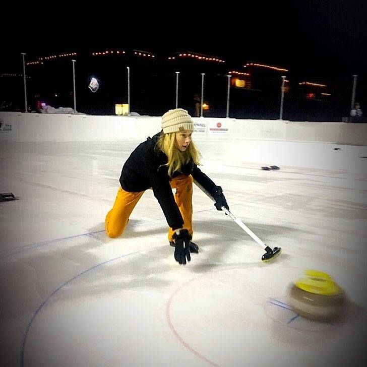 Photo by user rarebirdae, caption reads First night on the ice in town. Trying out my curling skills. #sendit #curling #bigsky #montana