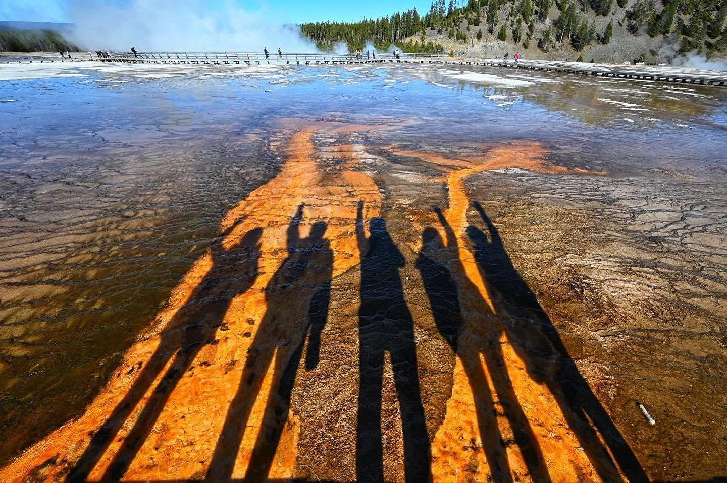 Photo by user rebecca0613, caption reads Another family trip checked. See you and until next time. 👋👋👋 #yellowstone #sanfrancisco #grandprismaticspring #familytrip #byebye #yellowstonenationalpark