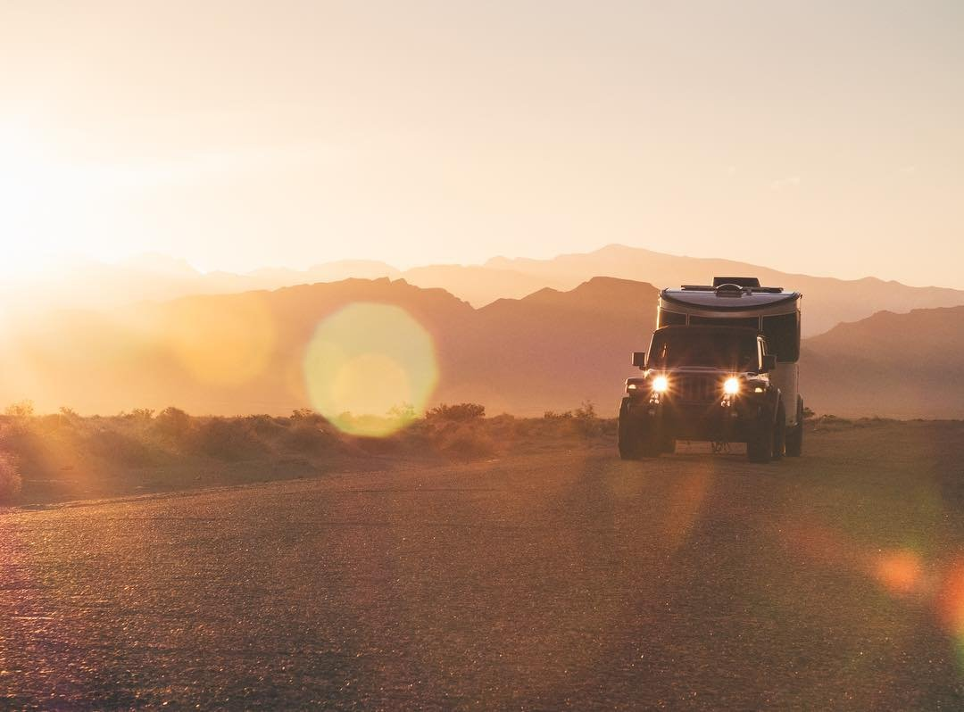 "Chasing sunrise in the Nevada desert with tylermcave and kyle_lamont this morning. It's been a blast dragging this airstream_inc Basecamp on the ""Death Drive"" and exploring the diverse landscapes of southern Nevada with an ace team and a badass adventure rig. #airstream  #goldenhour #onassignment  #nevada"