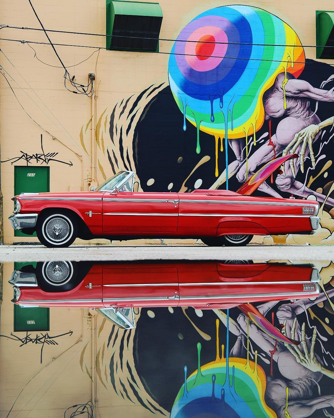 When art imitates life... Mural by: @alexpardee Ford Galaxie 500: @goodandshiddy #shineonstpete #puddlegram