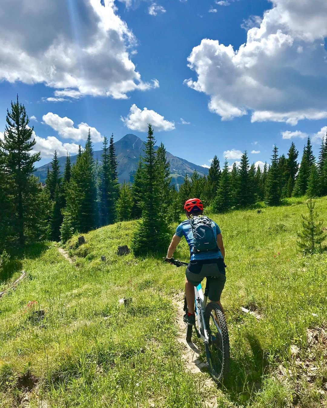 Photo by user dhirschi, caption reads Just me and my guy under one Big Sky! 👬  #bigsky #mtb #montana #summerdays #happyplace