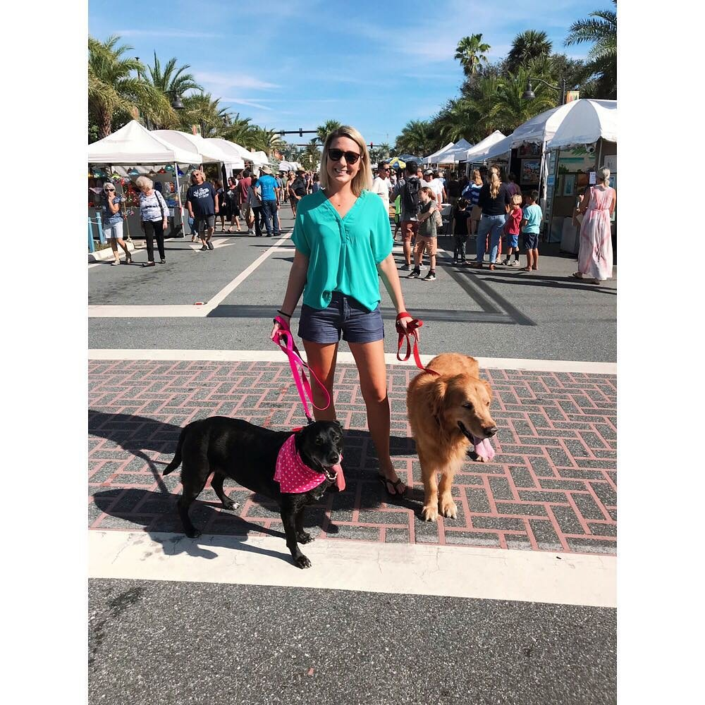 "Photo by user brookiemor, caption reads Everyone is showing off their artistic abilities?I'm over here like ""Yah, you can pet my dogs""? #artshow #dogmom #charliebrown #littleluna #beachlife"
