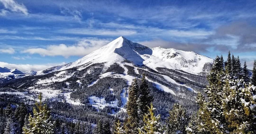 Photo by user noboundarieswithborders, caption reads Lone Peak sure doesn't look lonely to me! • • • • • #LonePeak #BigSkyResort #Montana #BigSkyCountry #VisitMontana #LastBestPlace #406 #BackyardMontana #SkiBum #SkiCulture #NaturalMontana #Nature #Beauty #Creation #BeautifulDestinations #TakeMoreAdventures #OptOutside #GetOutdoors #GetLost #GetOutStayOut #LifeIsBeautiful #LiveAuthentic #FolkScenery #LifeOfAdventure #LandscapePhotography #Samsung #Mountains #TravelStoke #ExploreToCreate #NoBoundariesWithBorders