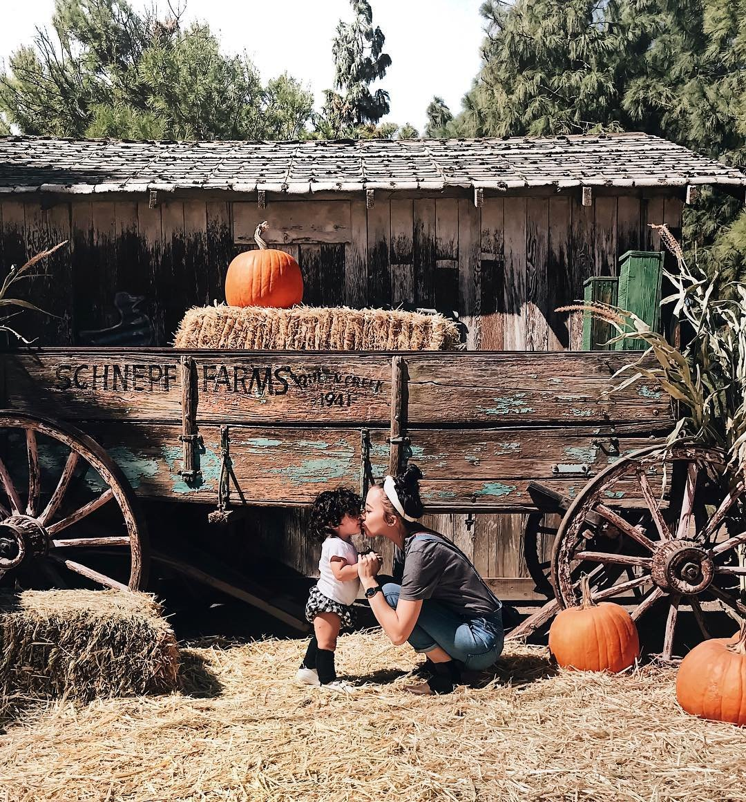 Photo by user shaemwoods, caption reads Took my babies to the pumpkin patch 🎃 and ate our weight in chili and corn bread 😋 so glad it's finally fall!