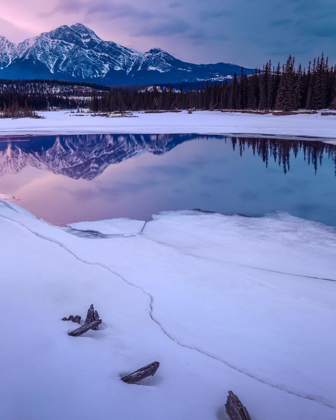 """Photo by user jasonmarinophotography, caption reads """"Separation Anxiety"""" – Ice cracking and separating along the shore of the Athabasca River in Jasper National Park, Alberta. Swipe for the much better full crop version.  For prints and other products, visit my website – link in bio."""