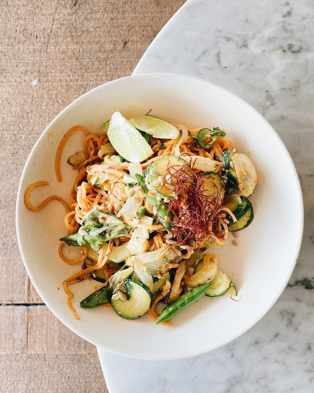 Photo by user texaztaste, caption reads Glow Bowl from @eatflowerchild has a delicious combination of sweet potato noodles with bok choy, zucchini, jalapeños, shiitake mushrooms, and snap peas in a coconut milk sauce. #flowerchild #glowbowl #vegan #azblogger #foodblogger #instafood #igfoodies #foodie #foodwriter #foodstagram #azfoodie #foodphotographer #foodlover #bloglovinfood #instafoodie #eater #dailyfoodfeed #foodbeast #phoenixeats #phoenixfoodie #huffposttaste #texaztaste #eatsaz #azfoodblogger #foodandwine #thedailybite #myphx