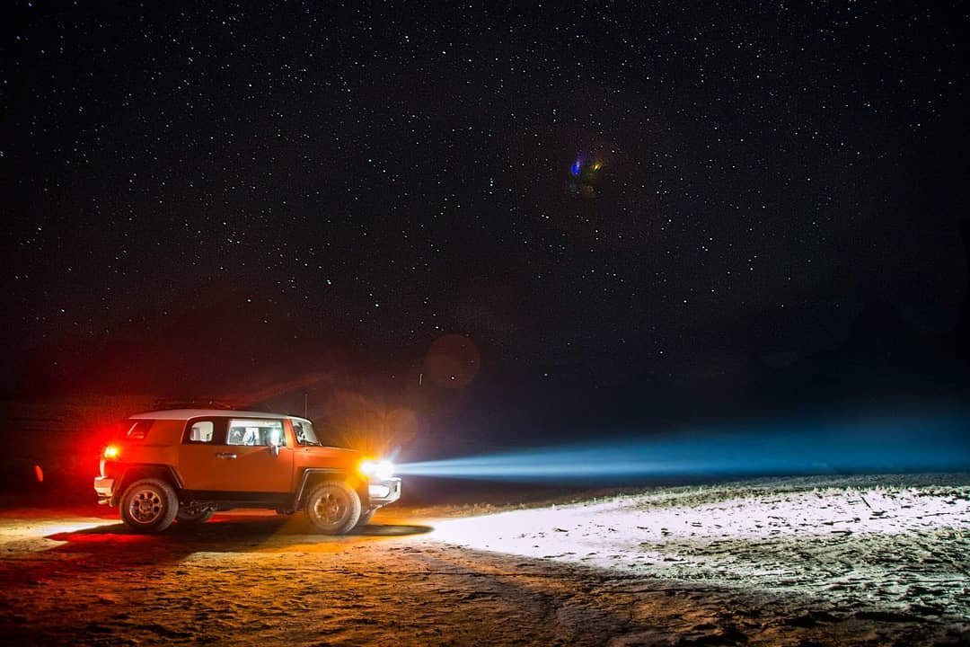 The crew traversing the #Moon during the #PerseidMeteorShower (actually the #BlackRockDesert). F/8.0, 30 second exposure.  toyotausa fjjcruiser fjcruiser_toyota fjcruiser_allterrain #775 #northernnevada #nevada #nevadadesert travelnevada #dfmi #fjcruiserforums #fjcruisers #fj #fjcruiser #magmafj #desert #highdesert #4x4 #offroading #offroad #overland #overlanding #renonv #nv #nvoffroad #meteorshower renotahoe #nightride #stars #nightsky #starfield #headlights #playa