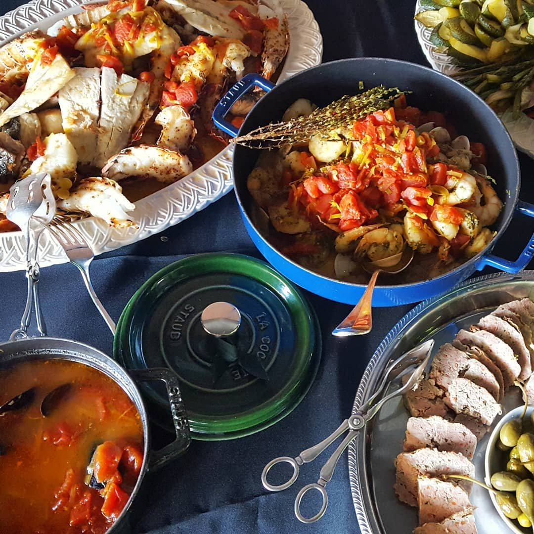 Photo by user sapienskitchen, caption reads For those of you who know what Bouillabaisse is this may not come as a surprise that it is served at Sapiens Kitchen today. After all, today, July 14th, is Bastille Day - French National Holiday. What Bastille Day without the most amazing seafood stew on the Planet - Bouillabaisse? Lobsters, langoustines, prawns, mussels, clams, scallops, 4 types of fish served over roasted local veggies and topped with a freshly made lobster and mussel stock broth infused with aromatic garden herbs. Chef Aurore rocks. Only at Sapiens. Vive la France ! #Bastilleday,#Frenchcuisine,#Frenchrestaurantscottadale,#Seafoodrestaurantscottsdale,#seafoodrestaurantsphoenix,#paleorestaurantsscottsdale,#bestseafoodscottsdale