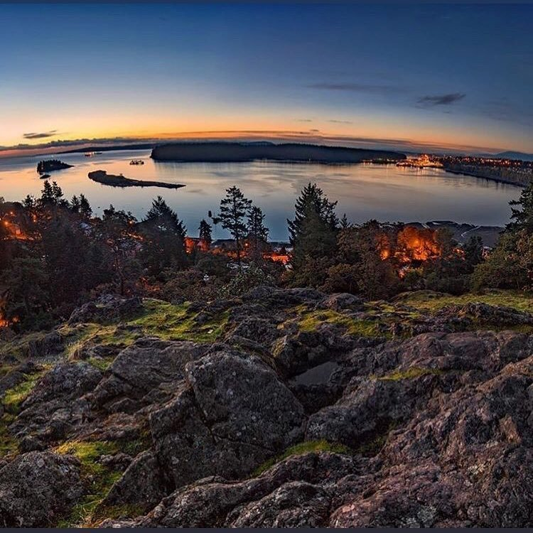 Photo by user justgovans, caption reads Sunrise from #sugarloafmountain as captured by ?? @craigletourneauphotography. ????Sugarloaf Mountain Park is a natural viewpoint overlooking picturesque #DepartureBay in #Nanaimo, #BritishColumbia #Canada ~ A perfect spot to watch stunning sunrises... ???????? . . . . #vanlifediaries #vanlifemovement #explorenanaimo #sharevi #vancouver #victoriabuzz #britishcolumbia #sharevancouverisland #camping #glamping #explorenanaimo #explorebc #explorecanada #getoutandexplore  #tofino #ucluelet #exploretocreate @tourismvancouverisland  @hellobc  #explorecanada #justgovans #canadaviews #thatbclife #campinglife #adventureculture