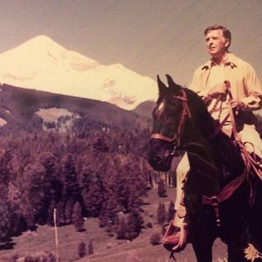 Photo by user bigskyresort, caption reads Chet Huntley enjoying the view on a horse in Big Sky. Date and photographer unknown. #throwbackthursday