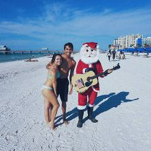 When you see a guy in a Santa costume playing guitar on the beach you know your life is complete🎄🎄☃