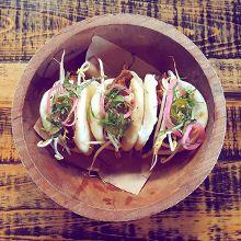 Pho Rolls at @StillwatersTavern: steamed bao, chili hoisin, marinated spiced beef, traditional garnish.