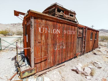 This train car was once a home, before being converted into a fuel station. Today, it's just another relic in a ghost town. - Southern NV . . . . #train #railcar #abandonedplaces #ghosttown #nevadadesert #caboose #roadtrip #exploremore #roamtheplanet #findnewplaces