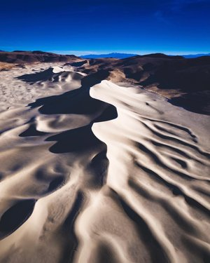 According to the Fallon Paiute-Shoshone Tribe...   A giant serpent left the Walker River and burrowed into the land.   Today, that serpent still lies in the ground, creating what many call Sand Mountain.   I would have never understood this until I saw it from above. #sandmointain #theserpent #fallon