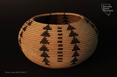 """Queen of the Basket Makers  Many of you have heard of Datsolalee the famous Washoe basket weaver also known as Louisa Keyser, but you may know few details of her life and work. She made this small coiled basket in 1896. It is the second basket listed in the ledger of Abe Cohn, owner of the Emporium, a Carson City shop known for selling Native American basketry and curios. Except for baskets she wove during her free time and personally sold or gifted, Datsolalee wove baskets exclusively for the Emporium. This basket, numbered LK No. 2 in the Emporium ledger, was purchased by Dr. S.L. Lee, a Carson City physician and friend of the Cohn's. Dr. Lee was an avid collector of Native American basketry. This beautifully made willow (Salix sp.) basket with bracken fern (Pteridium aquilinum) design is the earliest work of Datsolalee in the Nevada State Museum ethnographic basketry collection. Its form and design show her evolution away from the traditional Washoe utilitarian basket toward the degikup (globular) shape. Dr. Lee also kept a ledger of his basketry collection, which provides details about his baskets and their weavers. In Dr. Lee's ledger he writes, """"A Dot-So-La-Lee called the Queen of the Basket Makers. I knew her years before she gained fame as a basket weaver. She was residing on the Keyser Ranch in Douglas County, Nevada."""" He then writes, """"That she is a wonderful artist, no one who has seen her work can question."""" According to Dr. Lee's ledger he anxiously watched and waited while Datsolalee completed this basket. """"I saw it almost daily from the time she commenced until she finished it, which consumed just 35 days.""""  Thank you to the Washoe Cultural Resource Advisory Committee (WCRAC) for their continued assistance with Washoe related research.  Dr. Anna J. Camp will give a short presentation on this Datsolalee basket during the Museum's Curator's Corner program from 1:00 until 3:00 pm on Wednesday, January 6th.  https://www.carsonnvmuseum.org/events/  #NevadaS"""