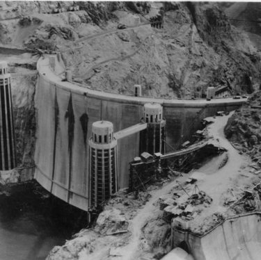 #OnThisDay in 1935, the last concrete was 'placed' in the construction of Hoover Dam.  There were two concrete mixing plants built at the site of Hoover Dam, or Boulder Dam as it was then called, in order to produce enough concrete in the time allowed to build the dam. An overhead 'bucket' system using pulleys to relay the concrete to where it was needed was devised - it was able to deliver one bucket of concrete every 78 seconds. The dam was built in 5ft deep vertical columns of blocks that varied in size from about 60 sq ft to 25 sq ft. The blocks were linked together like a giant Lego set. A unique cooling system to speed up the curing process of the concrete was developed, otherwise it had been calculated that it would take 100 years to cool without cracking. #museumfromhome TravelNevada #otd #hooverdam #history