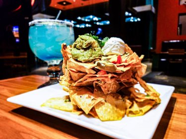 Wreck Nachos, the perfect appetizer to Taco Tuesday.   Make Your Reservation @ The Salted Lime tonight (702) 692-7777  #TacoTuesday #Nachos #Aliante