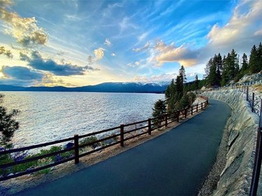 """If Tahoe can claim """"America's Most Beautiful Bike Ride,"""" the annual bicycle event around the Lake, then surely the recently completed Tahoe East Shore Trail, from Incline Village to Sand Harbor is """"The World's Most Beautiful Trail."""" Opened in 2019, this spectacular path, available to both bikes and walkers, offers breathtaking views of Lake Tahoe, and is an unforgettable experience for visitors and locals alike.  The trail begins off Highway 28 on the east side of Incline Village, with parking available in front of the old Ponderosa Ranch location. Stop in the tunnelcreekcafe for a cup of java, pastry or sandwich before the journey. If you need two wheels, you can rent bikes at flumetrailbikes, behind Tunnel Creek Cafe, villageskiloft in Incline Village, or shorelinetahoe if you are coming from South Shore.  Read"""