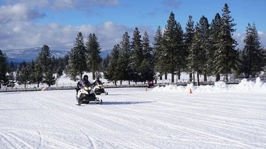 Feel the wind in your hair and cure your need for speed on our snowmobile track. #TahoeSnowmobiles ❄️